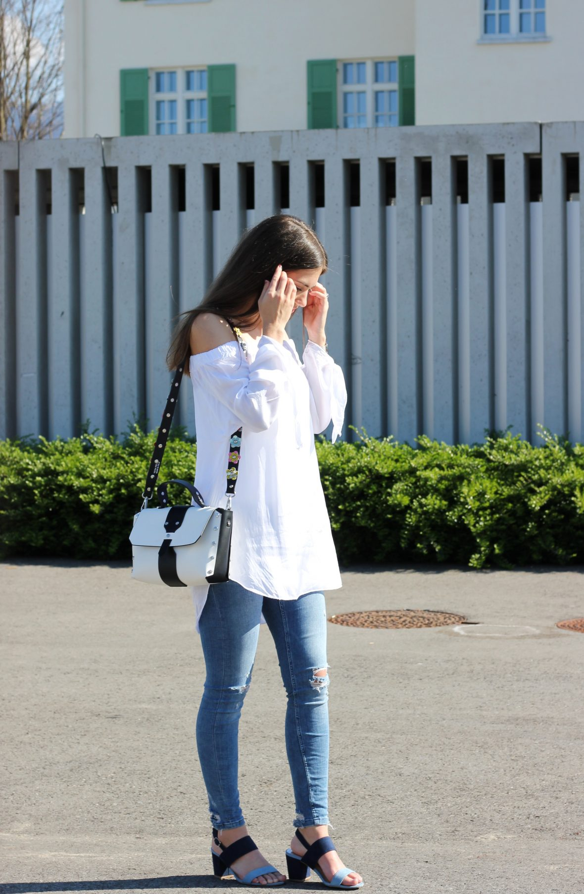 white blouse and blue jeans